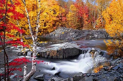 flowing waterfall in autumn